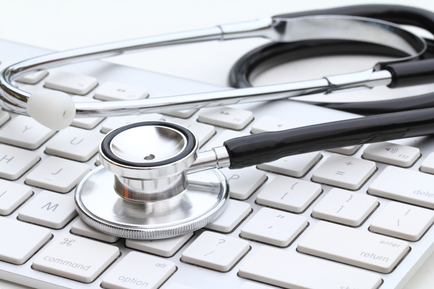 Stethoscope isolated on white with a modern computer keyboard